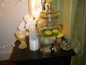 Fresh Garden Water: Mint leaves, slices of cucumber, lemon, and limes!  (And, flower-shaped ice cubes frozen with Mint Leaves!)