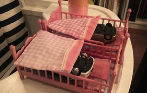Cars in doll beds.